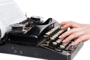 hands-typing-on-classic-typewriter